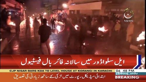 Festival participants chuck fireballs to celebrate