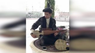 Sufiyan Malik was playing Rabab on winters first snowfall in Kashmir