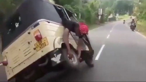 A man who can drive and fix rikshaw at the same time