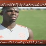 Paul Pogba kicks football during a live interview