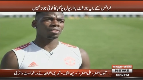 Paul Pogba kicks football during a live interview