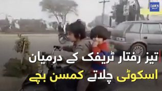 Children driving a scooter amidst heavy traffic