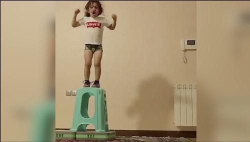 Cuteness Overload: Little girl jumps on stool
