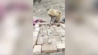 Children play pool with bricks