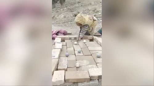 Children play pool with bricks