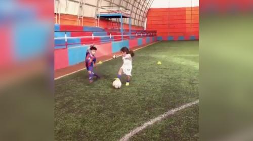 Young girl displays football skills