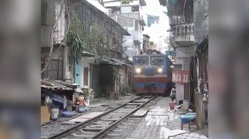 Train in a busy street