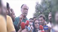 Ahsan Iqbal talks to the media