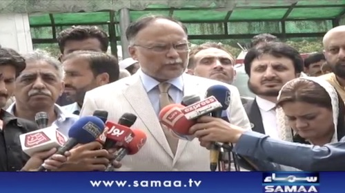 PML-N leader Ahsan Iqbal is talking to media in Islamabad